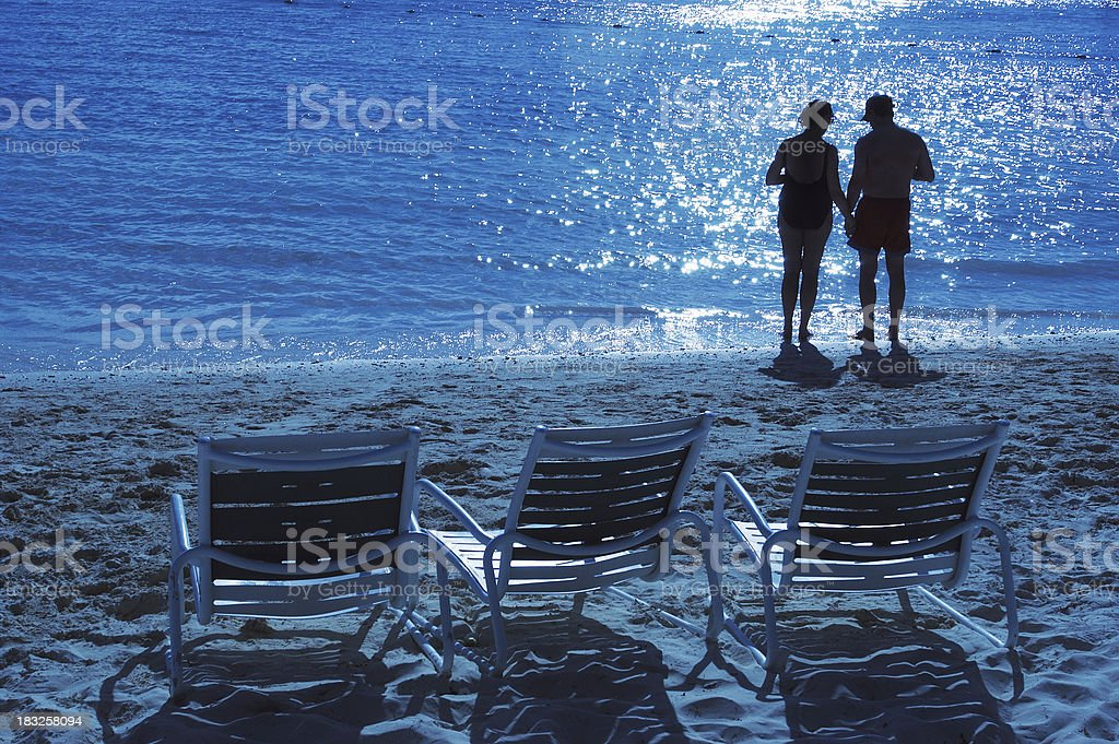 Middle-aged couple on beach royalty-free stock photo
