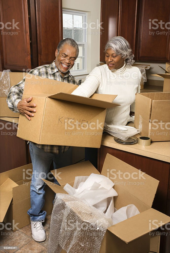 Middle-aged couple unpacking boxes. royalty-free stock photo