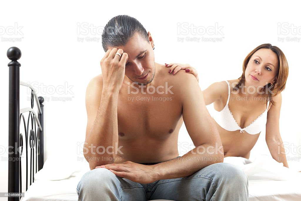 Middle-aged girl consoling the depressed husband royalty-free stock photo