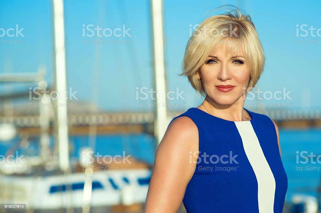 Middle-aged green-eyed gorgeous blond on the moorage stock photo