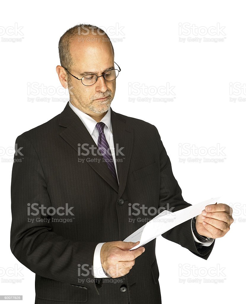 Middle-aged Man in Suit and Tie Reading Letter Frowning Isolated royalty-free stock photo