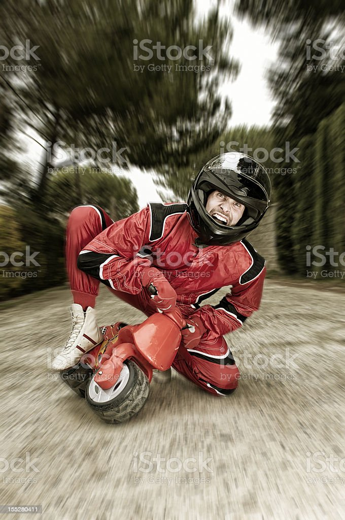 Middle-aged man on red children's bike on blurry background royalty-free stock photo