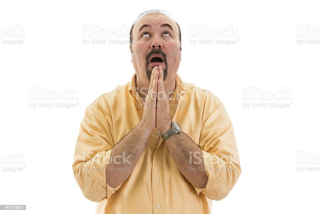 Middle-aged man praying to heaven for help stock photo