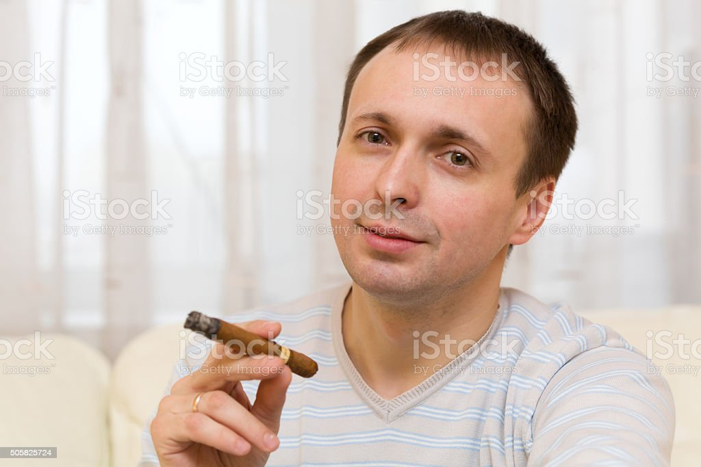 Middle-aged man smoking a cigar stock photo