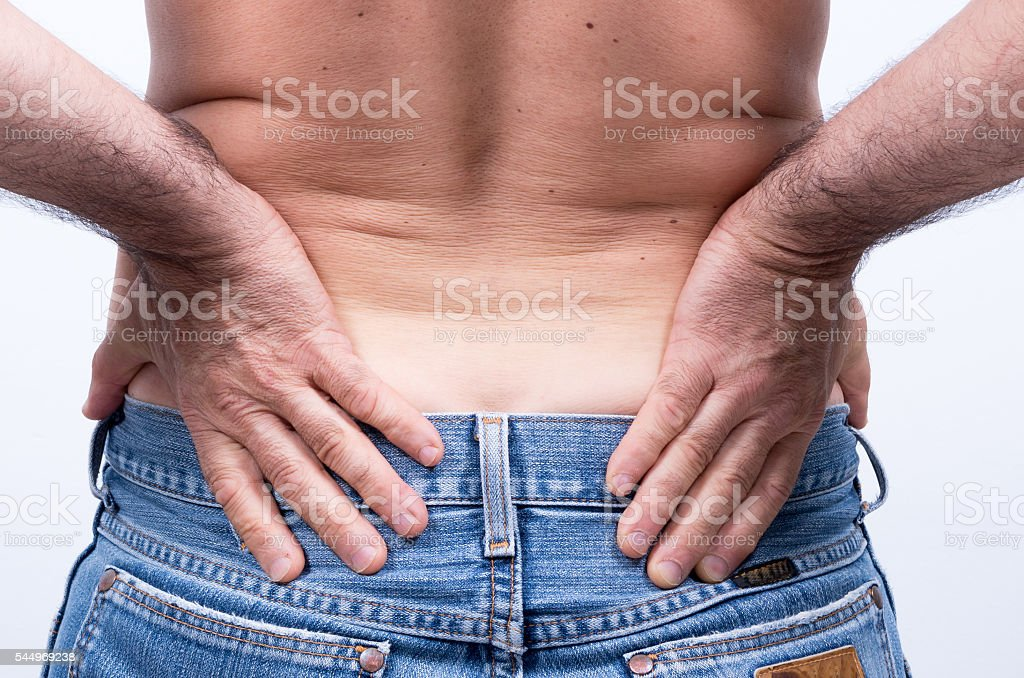 middle-aged man with severe pain in the lumbar region stock photo