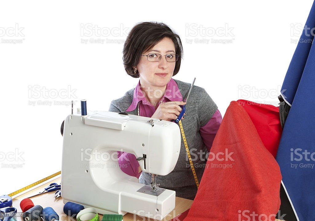 Middle-aged woman holding a pair of scissors. royalty-free stock photo