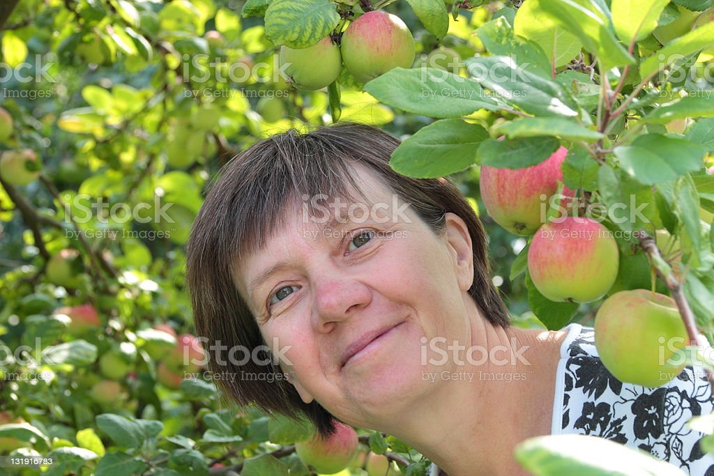 middle-aged woman in the garden stock photo