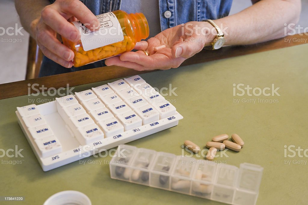 middle-aged woman taking pills royalty-free stock photo