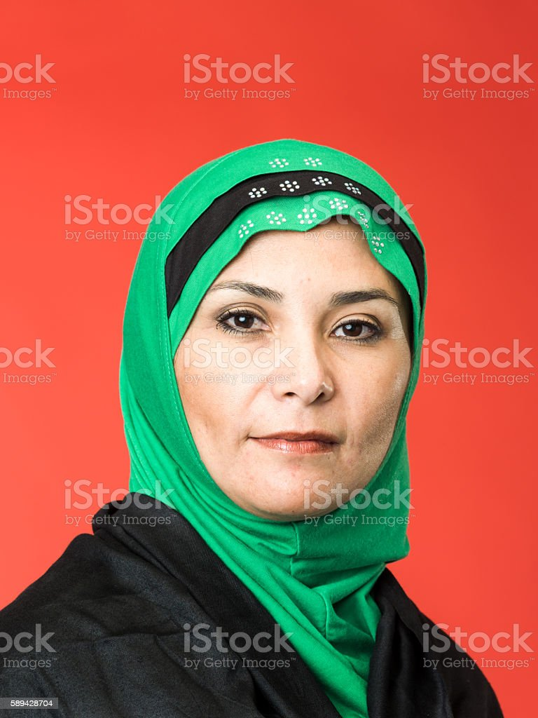 Middle-aged woman wearing a middle eastern headscarf stock photo