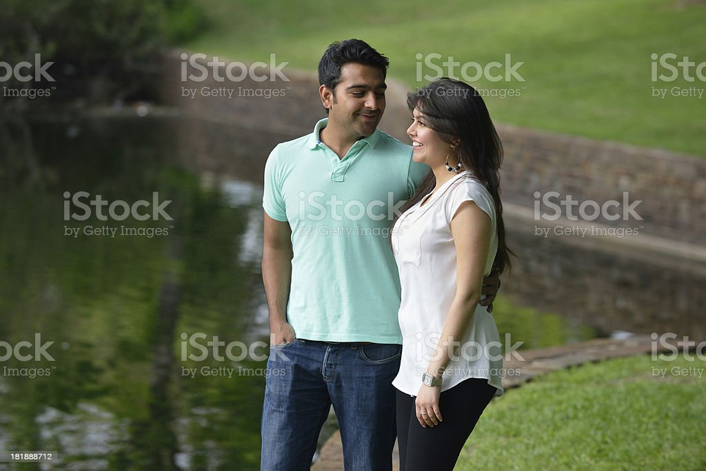 Middle-Eastern couple enjoying walk in the park royalty-free stock photo