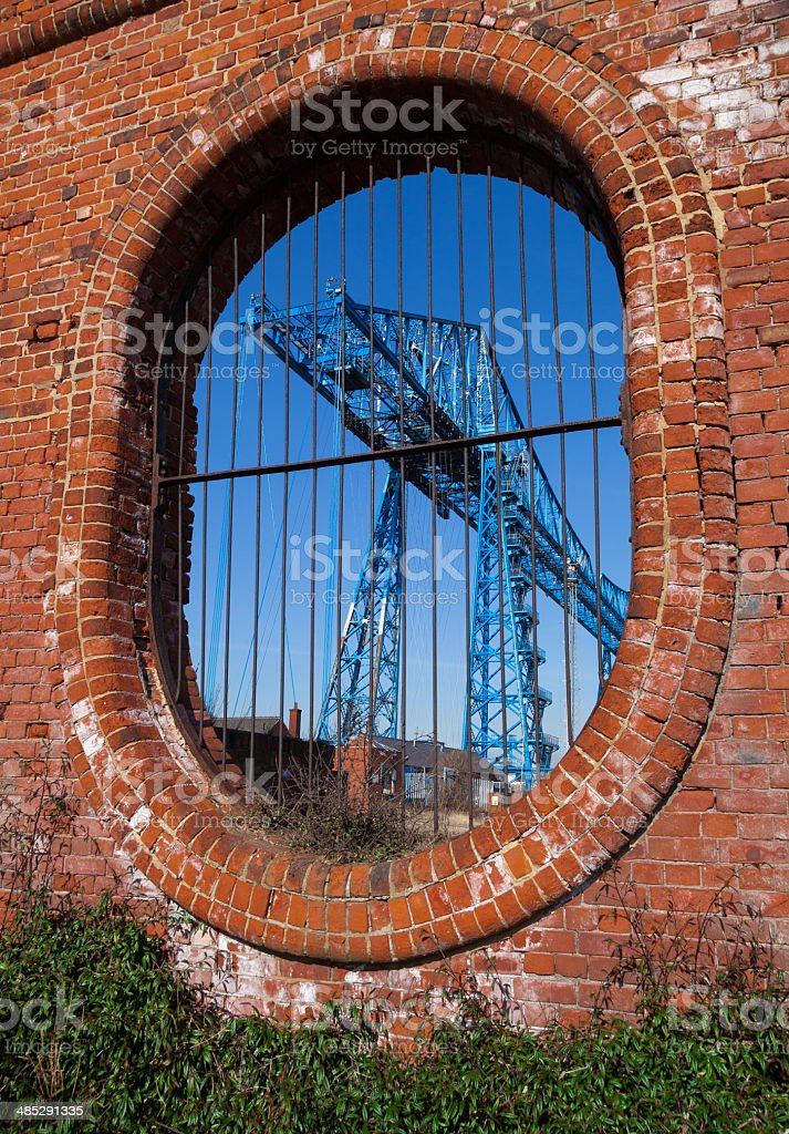 Middlesbrough Transporter bridge framed by an oval brick wall stock photo