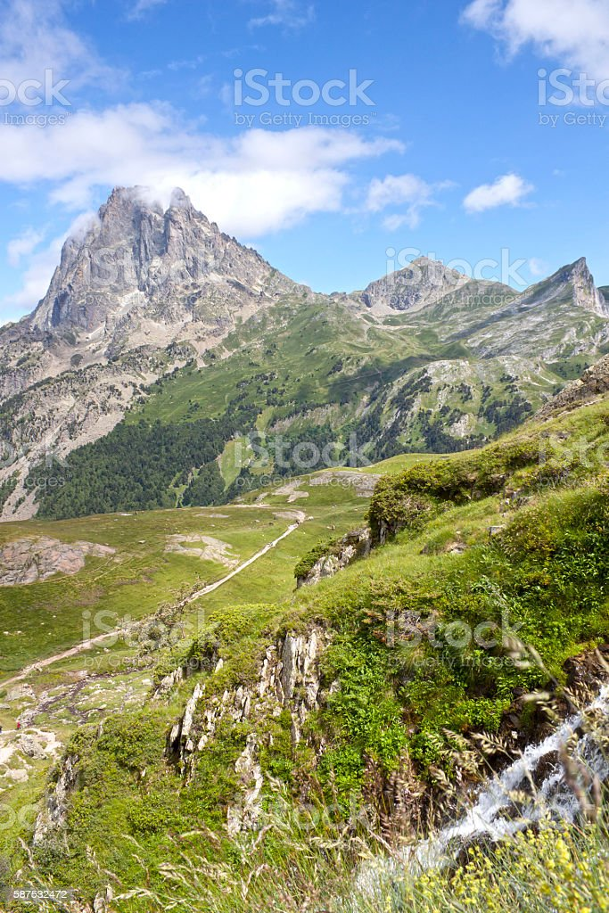 Midi d'Ossau peak and a waterfall in Ayous lakes stock photo