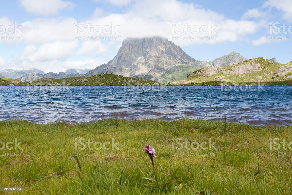 Midi d'Ossau peak and Ayous lake in a valley stock photo