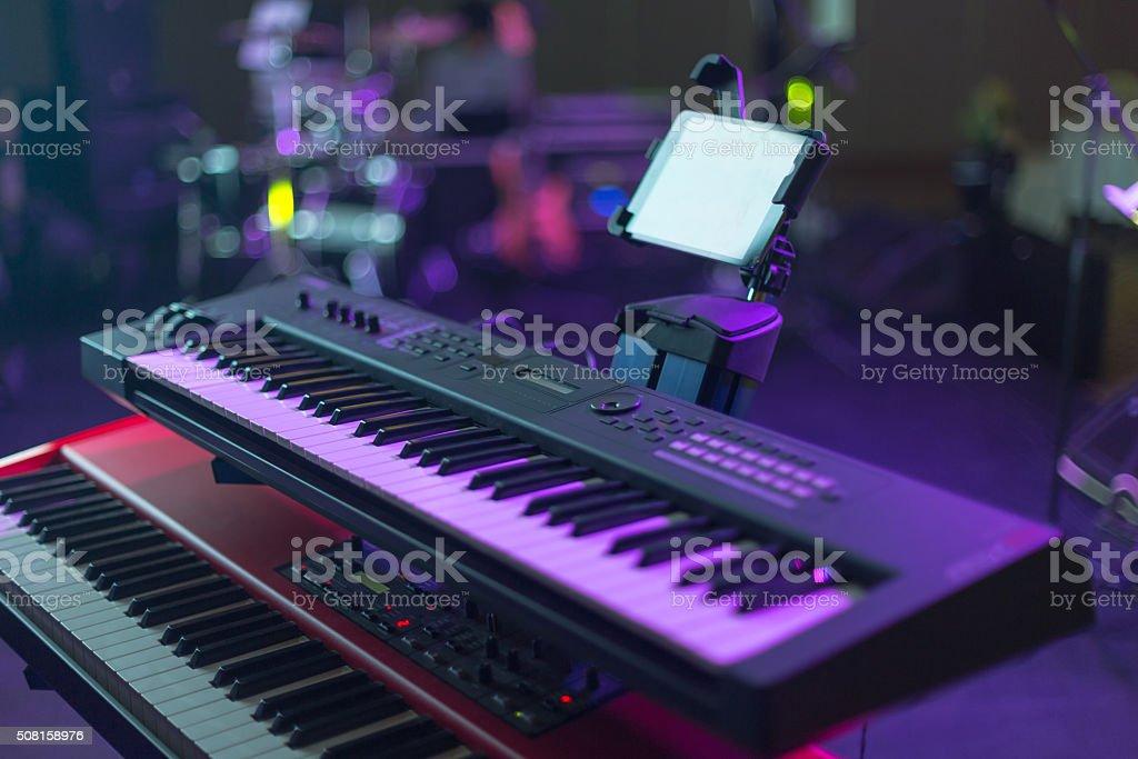 Midi Keyboard in concert hall stock photo
