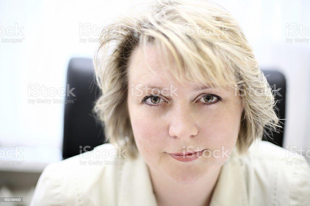 Mid-life business woman look at camera royalty-free stock photo
