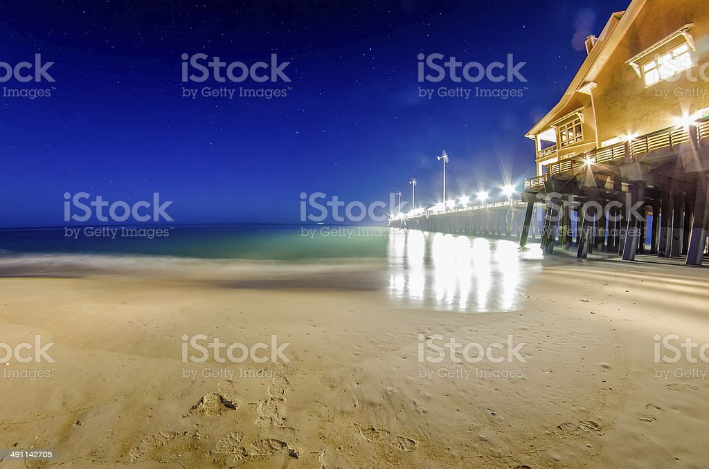 midnight at nags head pier and beach scenes stock photo