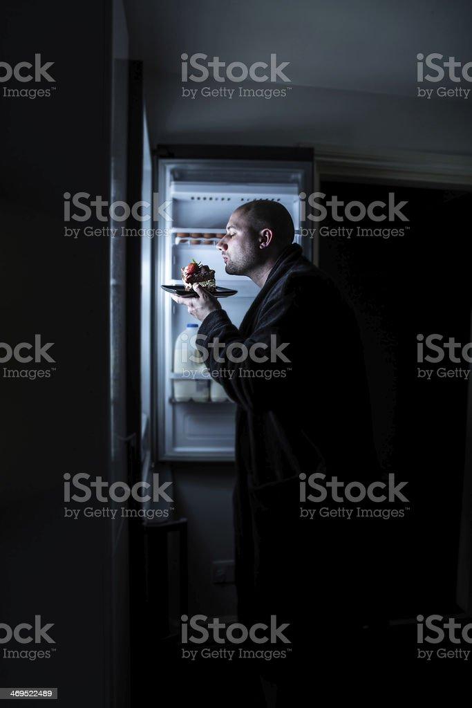 Midnight Cake Snacking stock photo