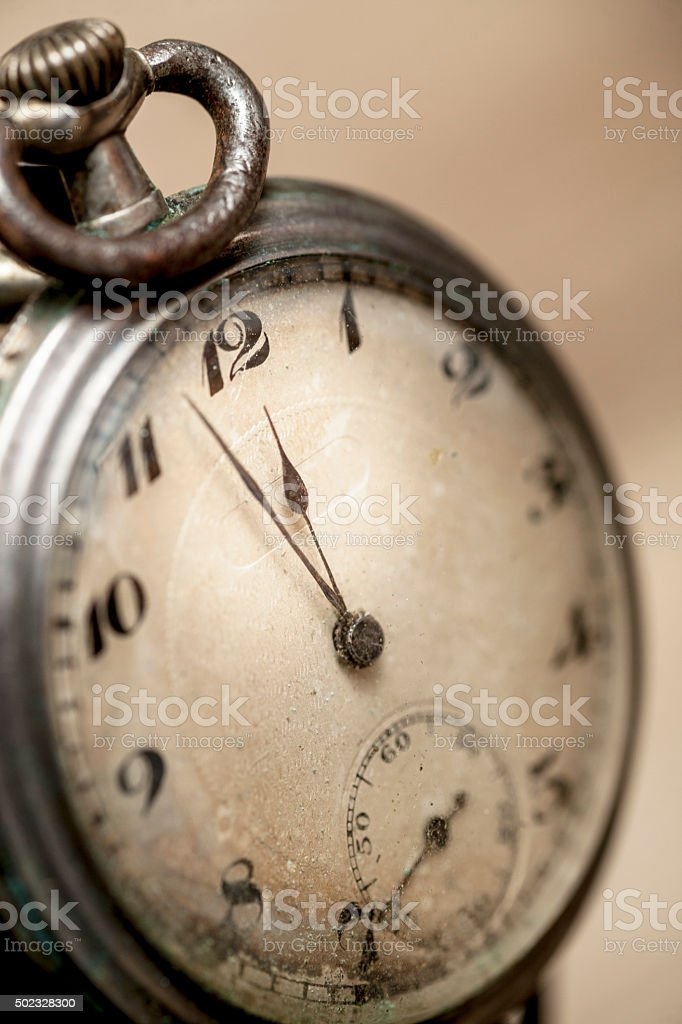 Midnight in and old pocket watch stock photo