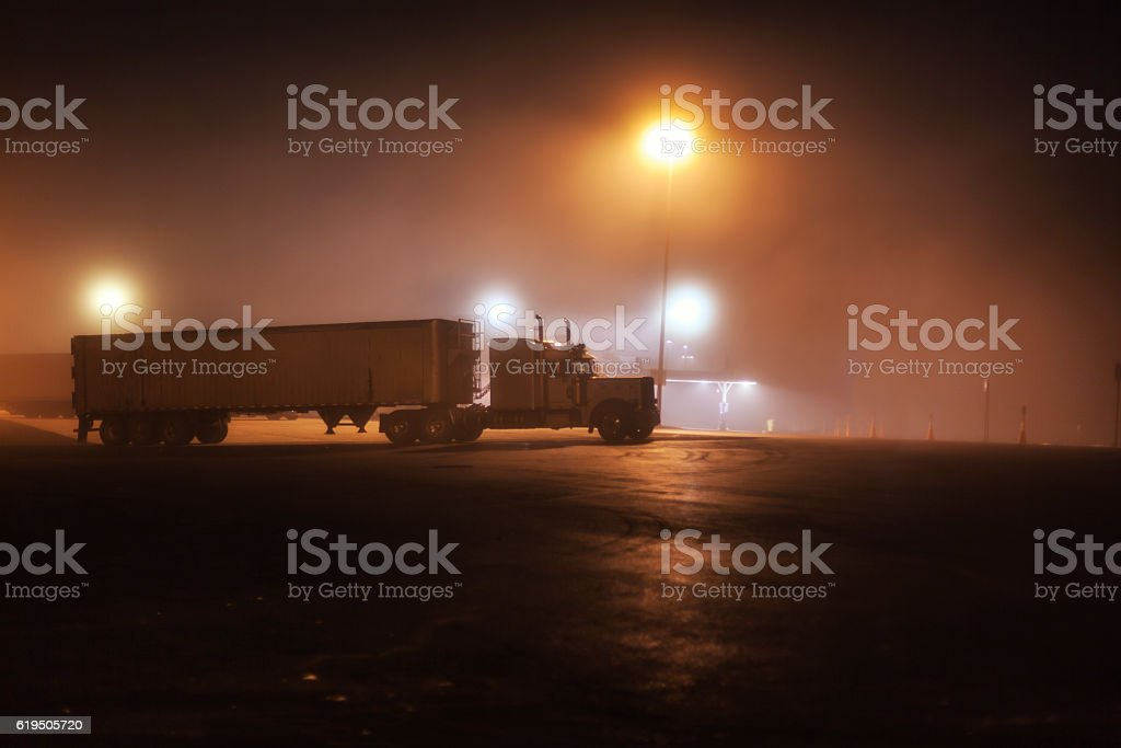 Midnight Interstate Expressway Foggy Rest Stop Parked Trailer Truck stock photo