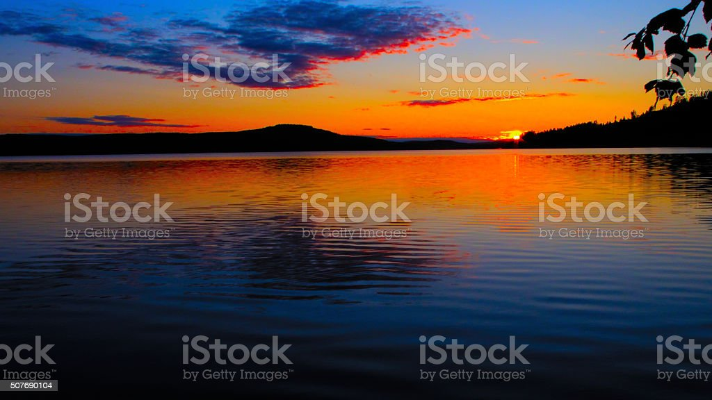 Midnight Sun on a lake stock photo