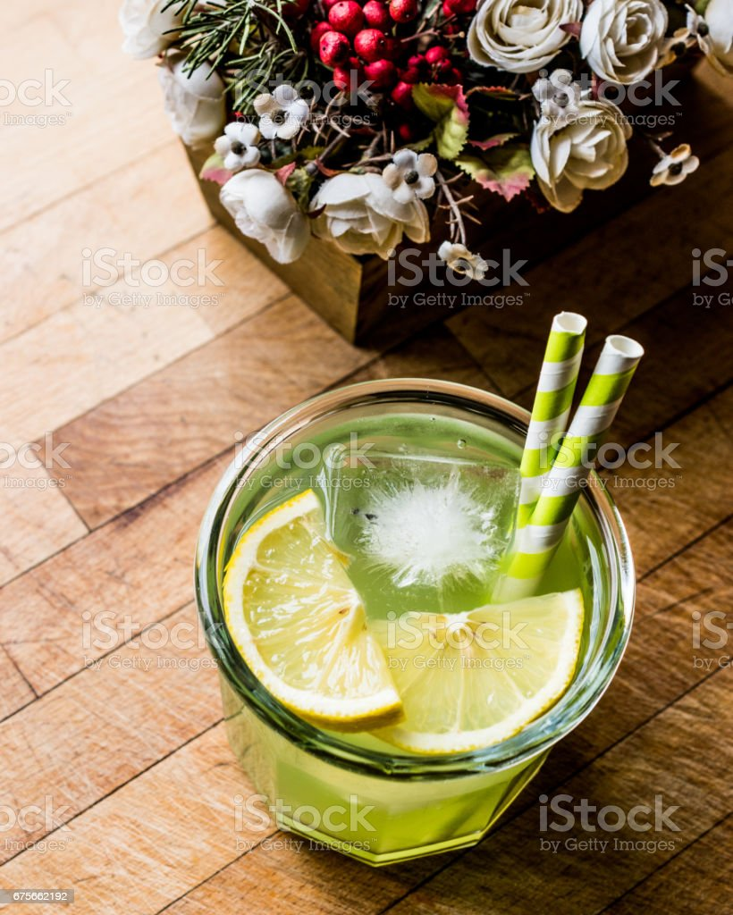 Midori Sour Cocktail with ice and lemon. stock photo