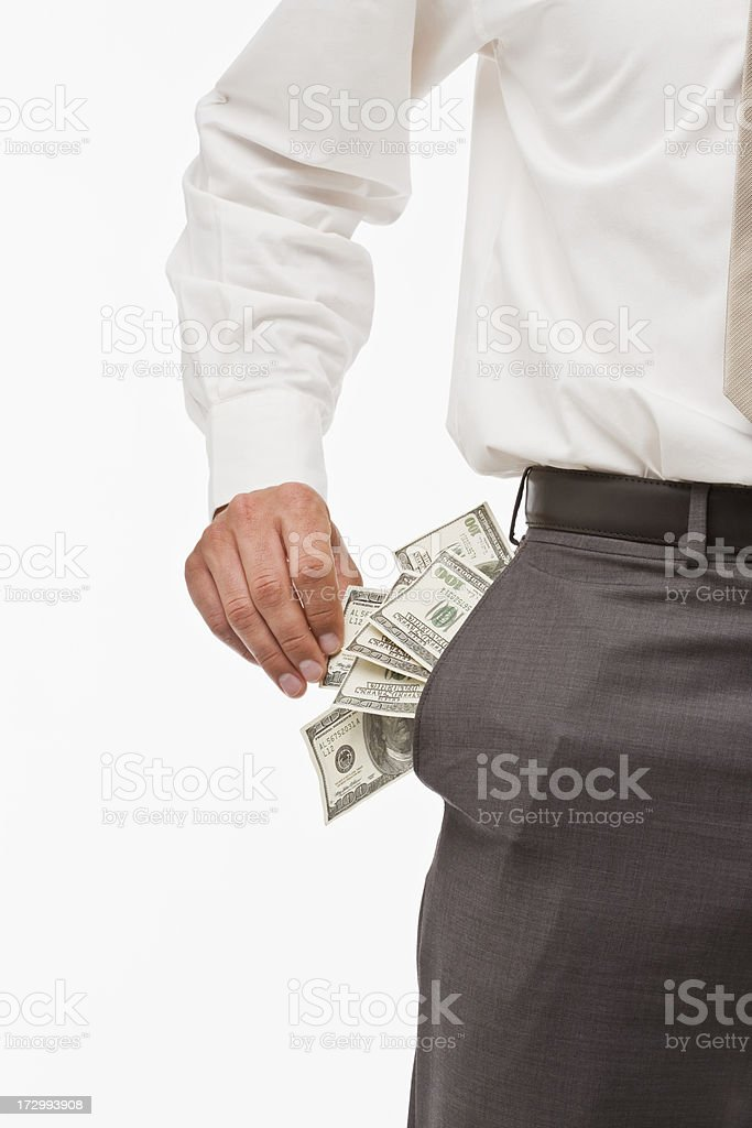 Midsection of a man with money in pocket stock photo