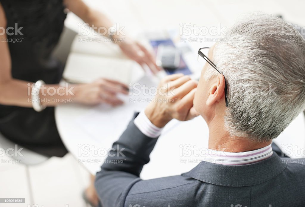 Midsection of a woman discussing work with a businessman royalty-free stock photo
