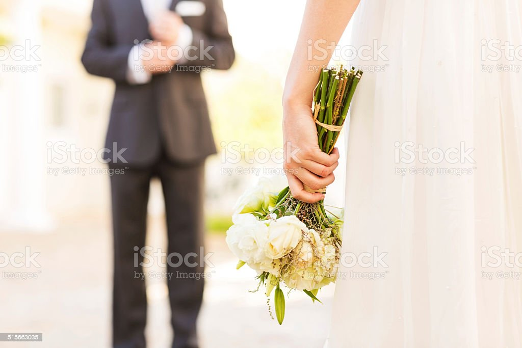 Midsection Of Bride Holding Flower Bouquet stock photo