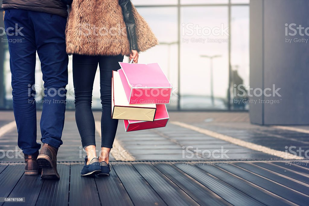 Midsection of couple with shopping bags stock photo