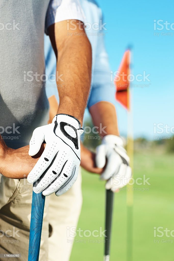Midsection of golf player standing royalty-free stock photo