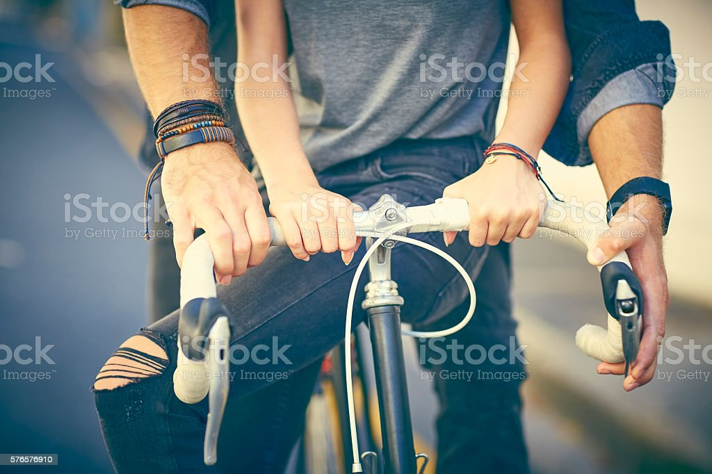 Midsection of loving couple riding bicycle stock photo