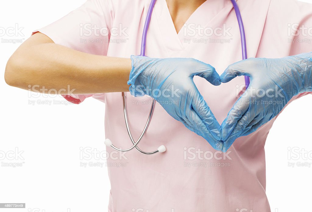 Midsection Of Nurse Making Heart Shape With Hands stock photo
