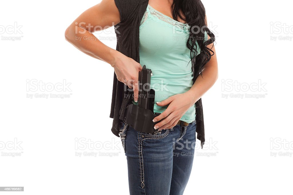 Midsection of woman with handgun stock photo
