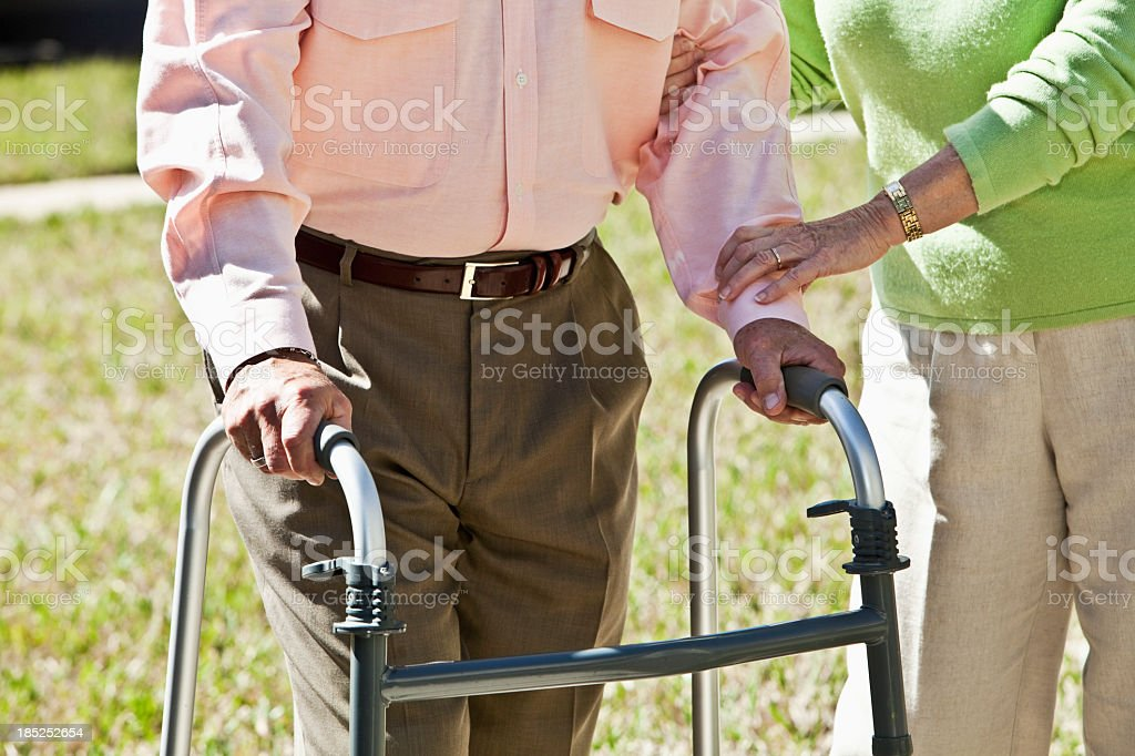 Midsection, senior couple with walker stock photo