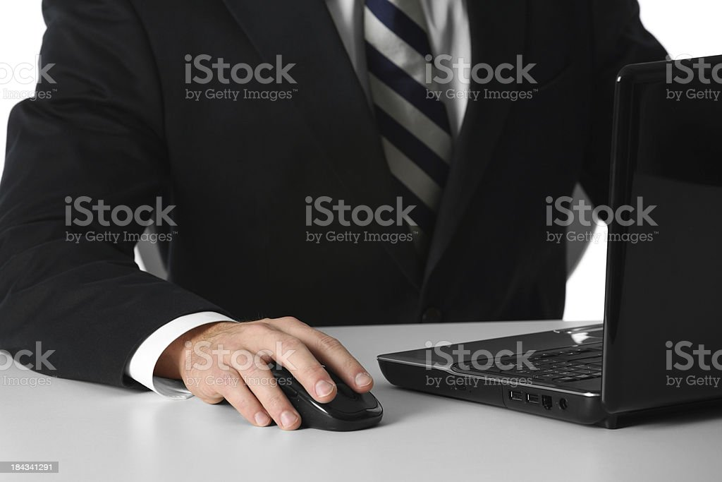 Midsection view of a businessman using laptop royalty-free stock photo