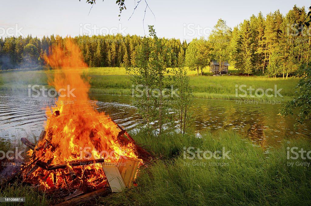 Midsummer Bonfire Lake Finland stock photo