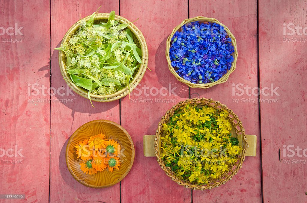 midsummer time medical herbs flowers in wicker baskets stock photo