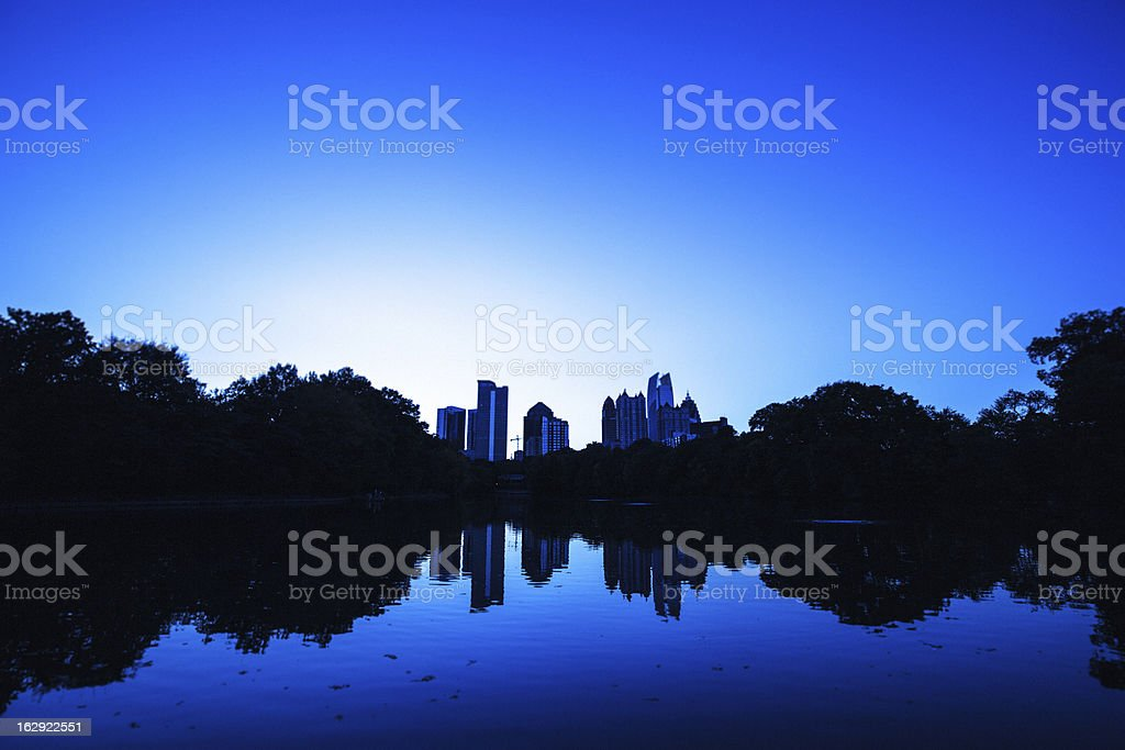 Midtown Atlanta reflected in the lake at night royalty-free stock photo