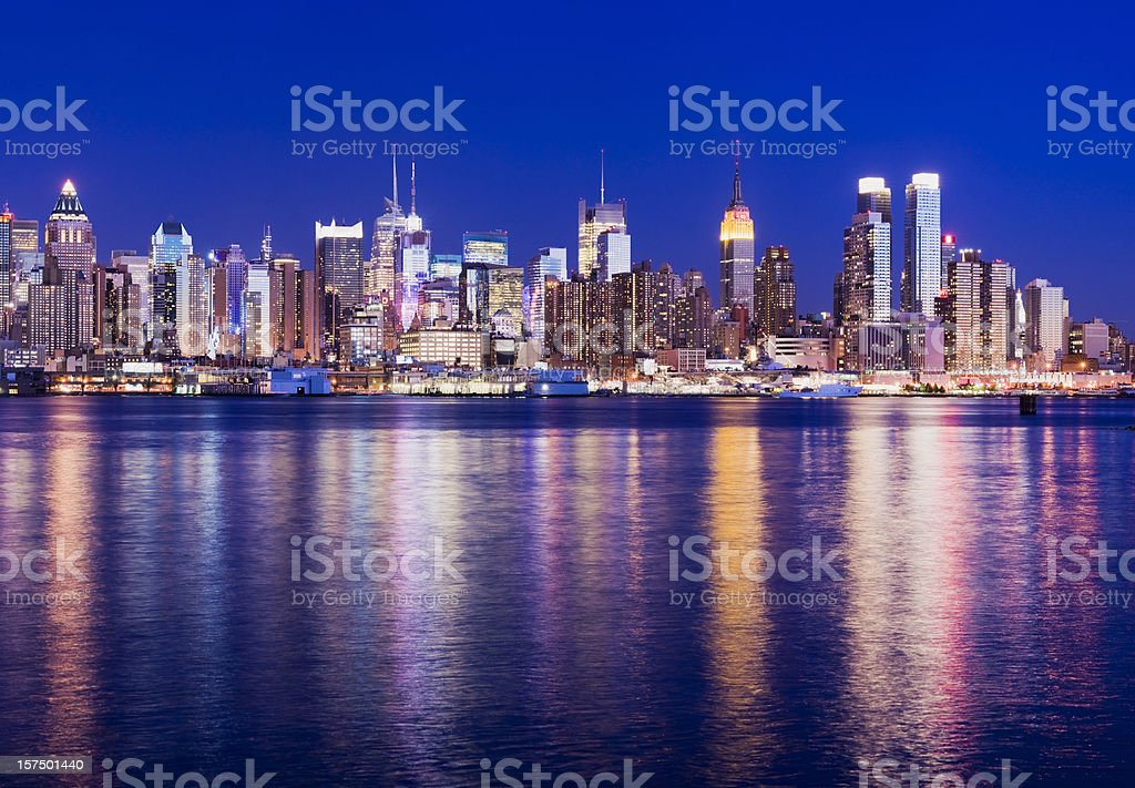 Midtown Manhattan City Skyline at Night in New York USA royalty-free stock photo