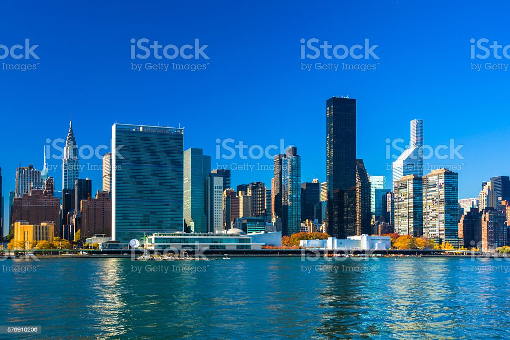 Midtown Manhattan Skyline with Chrysler Building, UN Plaza and River stock photo