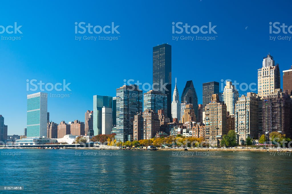 Midtown Manhattan skyscrapers from East River stock photo