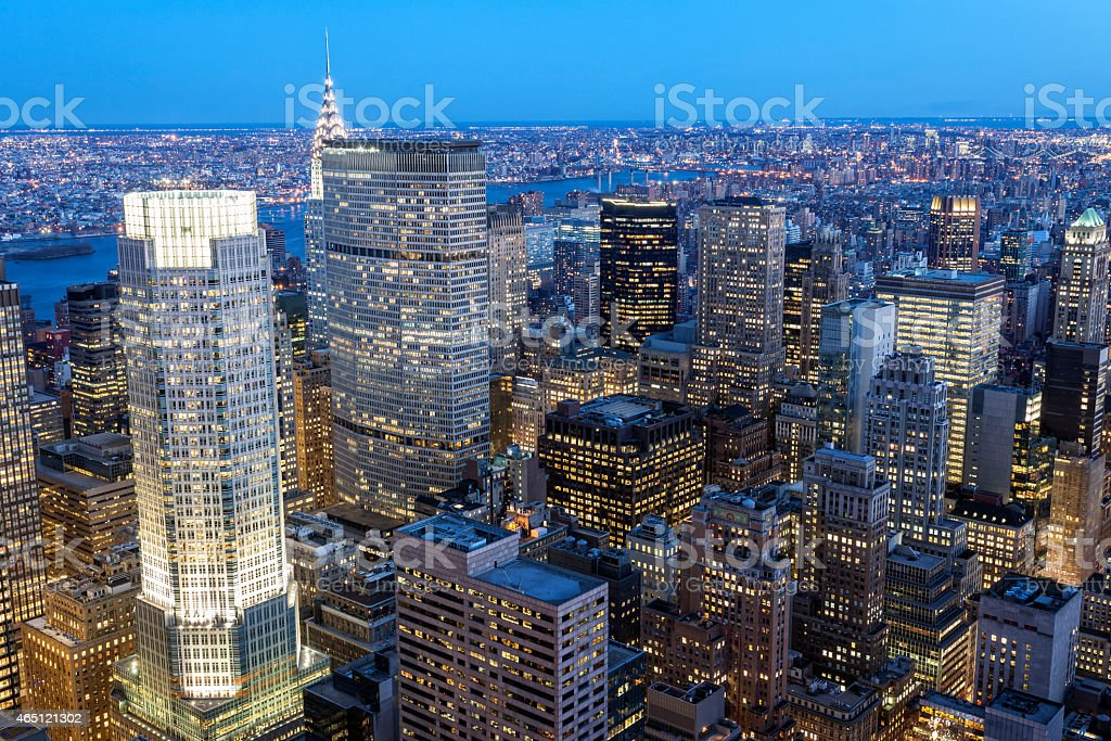 Midtown Manhattan Skyscrapers Illuminated at Dusk stock photo