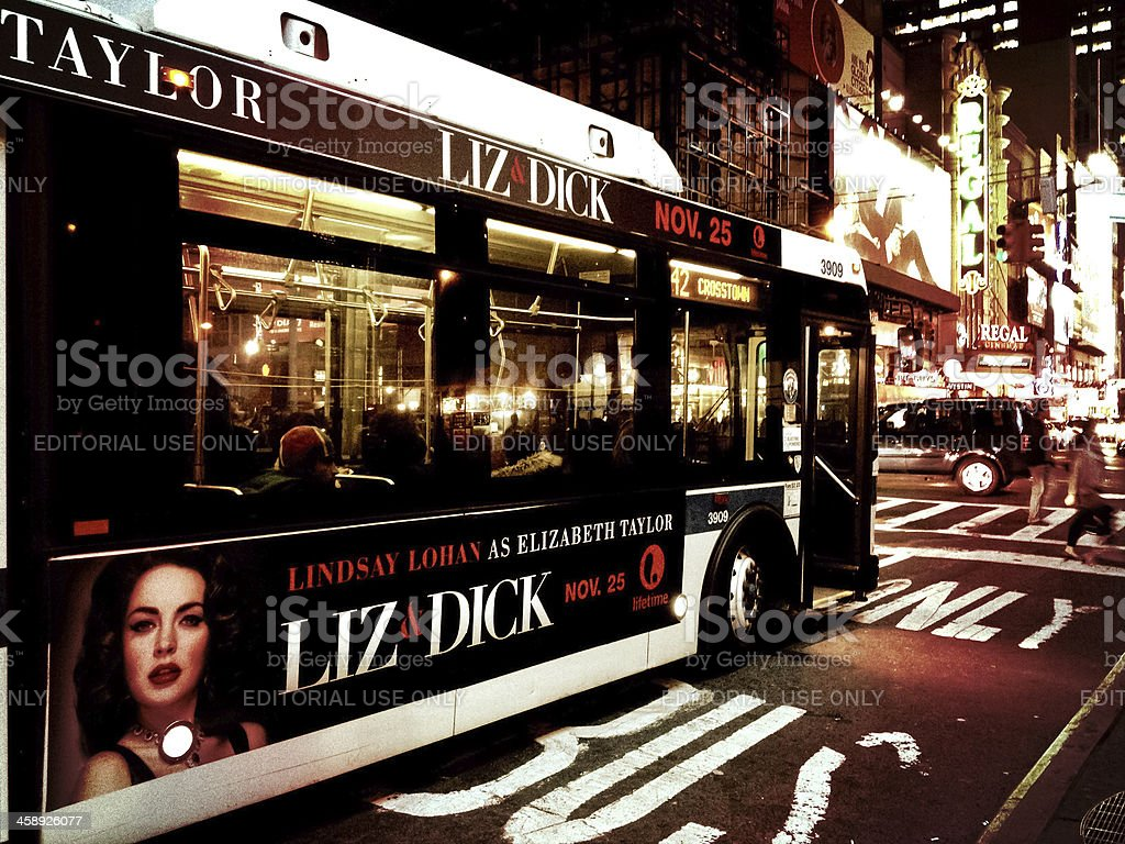 Midtown Manhattan traffic - movie ad on city bus stock photo