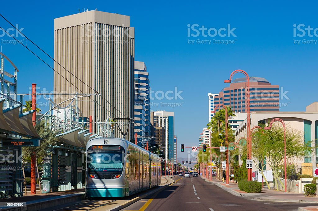 Midtown Phoenix business district and light rail train stock photo
