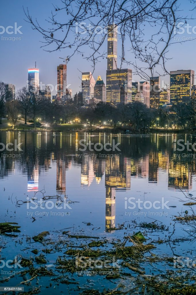 Midtown Skyline at night, view from the the lake in central Park, NYC stock photo