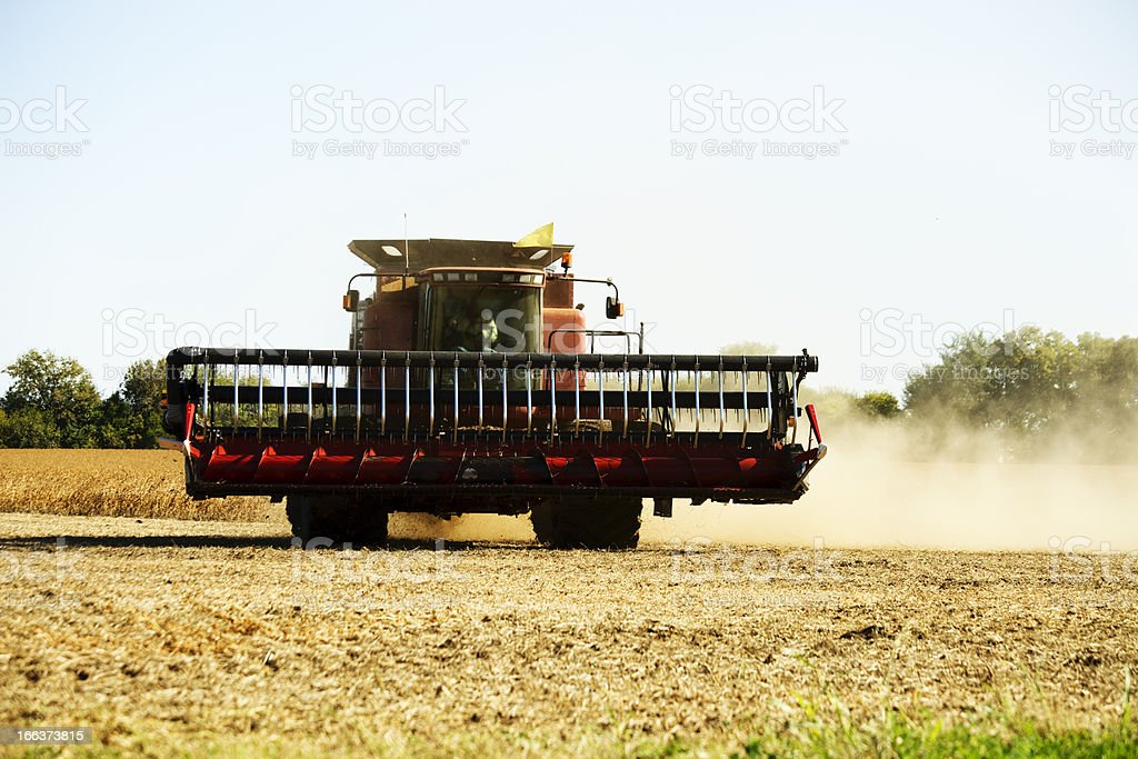 Midwest Farmer Harvests Soybean Crop with Combine Tractor royalty-free stock photo