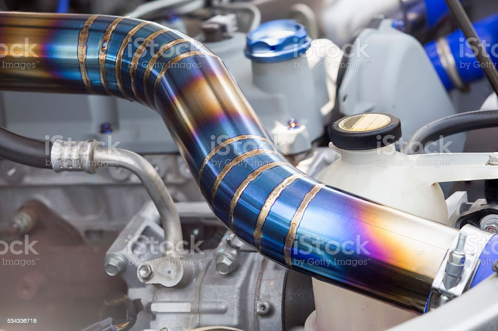 Mig welded seam on stainless steel pipe in racing car stock photo