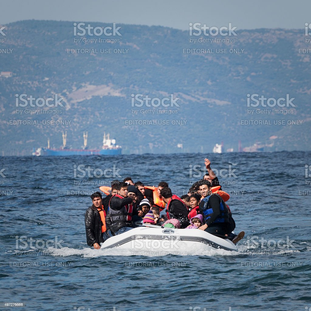Migrants arriving in Europe by boat stock photo