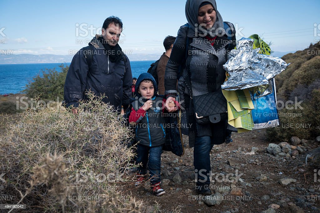 Migrants arriving on the beach in Lesbos, Greece stock photo