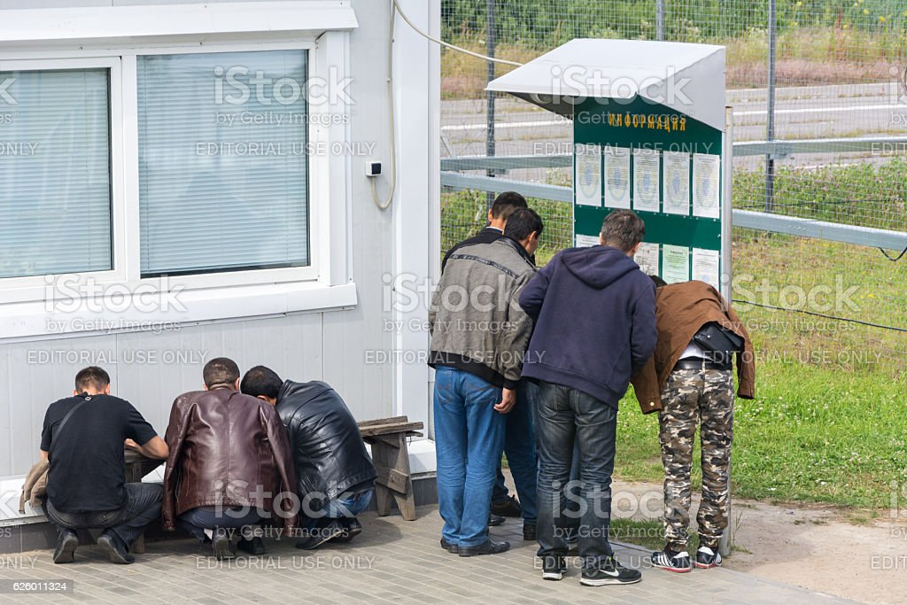 migrants fill the documents at the border stock photo